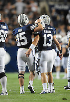 Sept. 19, 2009; Provo, UT, USA; BYU Cougars quarterback (13) Riley Nelson is congratulated by teammate (15) Max Hall after throwing a fourth quarter touchdown against the Florida State Seminoles at LaVell Edwards Stadium. Florida State defeated BYU 54-28. Mandatory Credit: Mark J. Rebilas-
