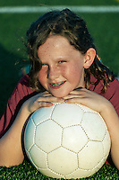 Girl with her soccer ball.