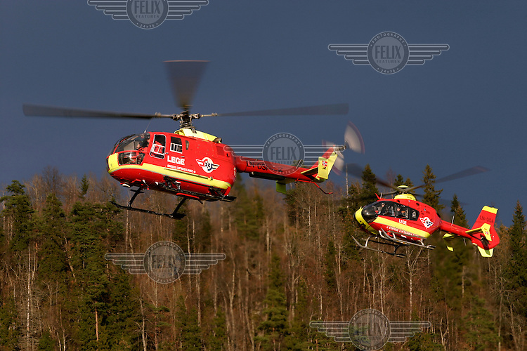 BO 105 CBS4 helicopter (front) and Eurocopter EC 135 P2  helicopter belonging to Norwegian Air Ambulance.