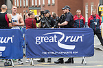 © Joel Goodman - 07973 332324 . 28/05/2017 . Manchester , UK . Armed police watch over the run . The Great Manchester Run 2017 . Security is still heightened in Manchester following a murderous bomb attack at an Ariana Grande gig at Manchester Arena on Monday 22nd May . Photo credit : Joel Goodman