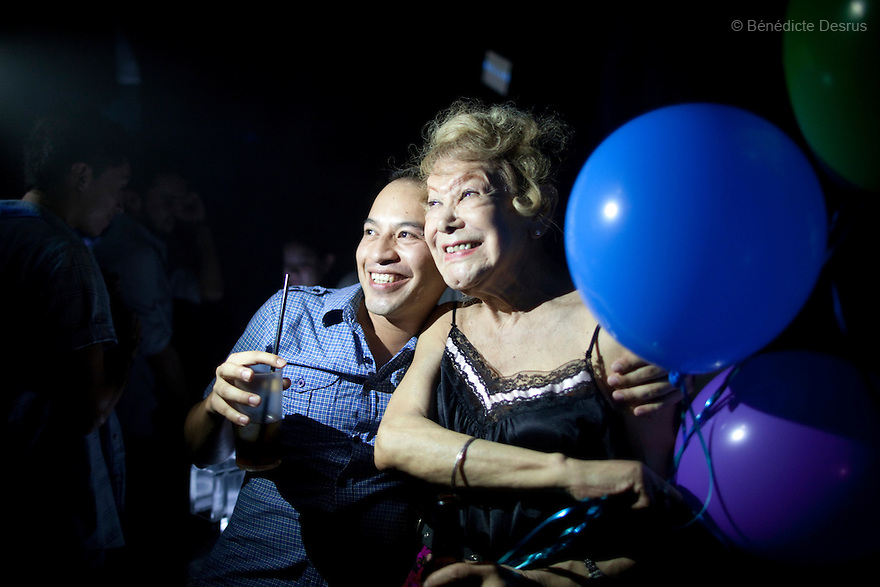 """September 8, 2012 - Mexico City, Mexico - Samantha dances at a nightclub inMexico City.Samantha Flores is an 80-year-old transgender woman from Veracruz, Mexico. She is a prominent social activist for LGBTQI rights and is the founder of the non-profit organization """"Laetus Vitae"""", a day shelter for elderly gay people in Mexico City. Senior citizens in general are many times prone to neglect and abandonment by their families, leaving them all but invisible. Their plight can be even worse if they are homosexual. Photo credit: Bénédicte Desrus"""