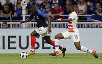 Lyon, France - Saturday June 09, 2018: Benjamin Mendy, Antonee Robinson during an international friendly match between the men's national teams of the United States (USA) and France (FRA) at Groupama Stadium.