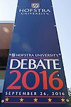 Hempstead, New York, USA. September 13, 2016. Hofstra University Debate 2016 banner, tall vertical in patriotic red white and blue, is one of many displayed on the campus of Hofstra University, which will host the first Presidential Debate, between H.R. Clinton and D. J. Trump, scheduled for later that month on September 26. Hofstra is first university ever selected for 3 consecutive U.S. presidential debates.