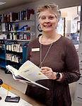 WOODBURY CT. 16 March 2018-031619SV05-Sue Piel, Director, works the circulation desk at the library in Woodbury Saturday.<br /> Steven Valenti Republican-American