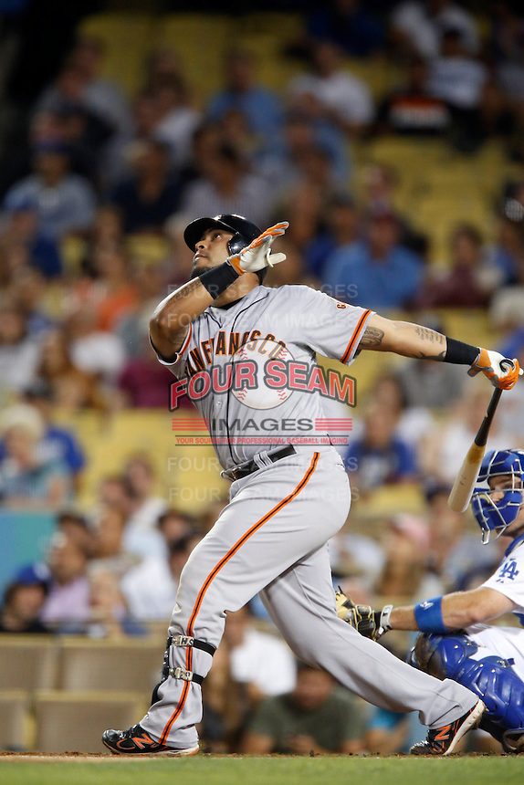 Hector Sanchez #29 of the San Francisco Giants bats against the Los Angeles Dodgers at Dodger Stadium on October 02, 2012 in Los Angeles, California. San Francisco defeated Los Angeles 4-3. (Larry Goren/Four Seam Images)