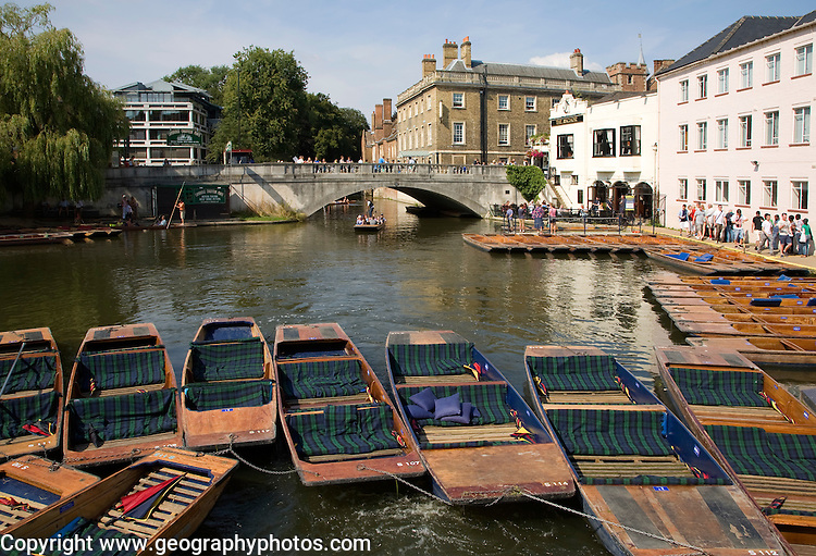 People punting in small boats on the River Cam near Silver Street Bridge, Cambridge, England