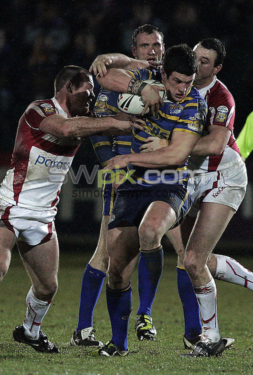 PICTURE BY VAUGHN RIDLEY/SWPIX.COM - Rugby League - Superleague - Hull KR v Leeds - Craven Stadium, Hull, England  - 20/02/09...Copyright - Simon Wilkinson - 07811267706...Leeds Luke Burgess struggle past Hull KR's Paul Cooke.