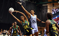21.02.2018 Jamaica's Shamera Sterling and Fiji's Maliana Rusivakula Kahatoka in action during the Jamaica v Fiji Taini Jamison Trophy netball match at the North Shore Events Centre in Auckland. Mandatory Photo Credit ©Michael Bradley.