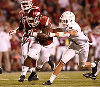 NWA Democrat-Gazette/MICHAEL WOODS • @NWAMICHAELW<br /> University of Arkansas running back Rawleigh Williams III slips past Texas State defender Javanese O'Roy to score a touchdown in the 3rd quarter, Saturday, September 17, at Razorback Stadium in Fayetteville.