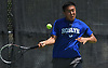 Sangjin Song of Roslyn returns from volley in the Nassau County varsity boys tennis doubles final at Oceanside High School on Sunday, May 21, 2017.