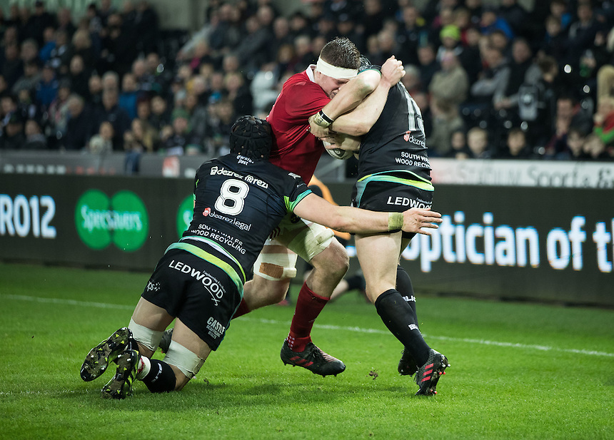 Munster's Jack O'Donoghue under pressure from  Ospreys' James King<br /> <br /> Photographer Simon King/CameraSport<br /> <br /> Guinness PRO12 Round 15 - Ospreys v Munster - Saturday 18th February 2017 - Liberty Stadium - Swansea<br /> <br /> World Copyright &copy; 2017 CameraSport. All rights reserved. 43 Linden Ave. Countesthorpe. Leicester. England. LE8 5PG - Tel: +44 (0) 116 277 4147 - admin@camerasport.com - www.camerasport.com
