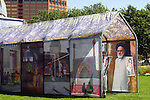An ornate tent housing photographs displaying the culture and lifestyles of the Iranian people.