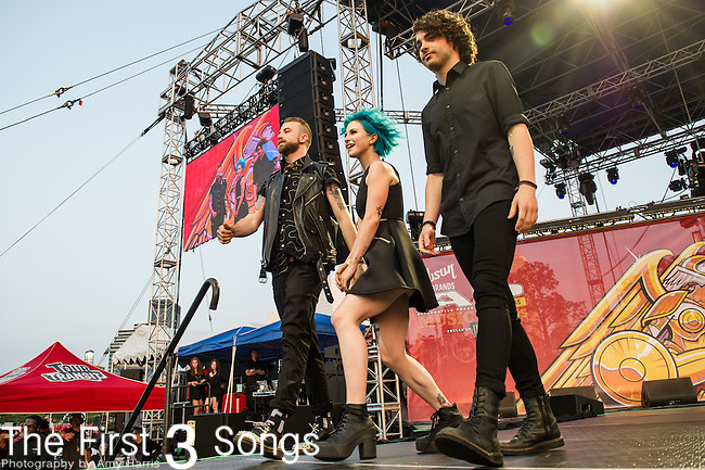 Hayley Williams, Jeremy Davis, and Taylor York of Paramore at the 2014 AP Music Awards at the Rock And Roll Hall Of Fame and Museum at North Coast Harbor in Cleveland, Ohio.