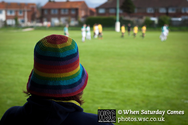 A fan in a colourful hat watching the second-half action at Mount Pleasant as Marske United (in yellow) take on Billingham Synthonia in a Northern League division one fixture. Formed in 1956 in Marske-by-the-Sea, the home club had secured automatic promotion to the Northern Premier League two days before and were in the midst of a run of six home games in 10 days as they attempted to overtake Morpeth Town to win the league. They won this match 6-1 against already relegated Billingham, watched by a crowd of 196.