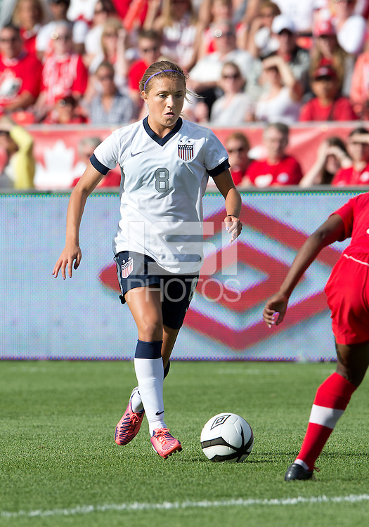 02 June 2013: U.S. Women's National Team midfielder Kristie Mewis #8 in action during an International Friendly soccer match between the U.S. Women's National Soccer Team and the Canadian Women's National Soccer Team at BMO Field in Toronto, Ontario.<br /> The U.S. Women's National Team Won 3-0.