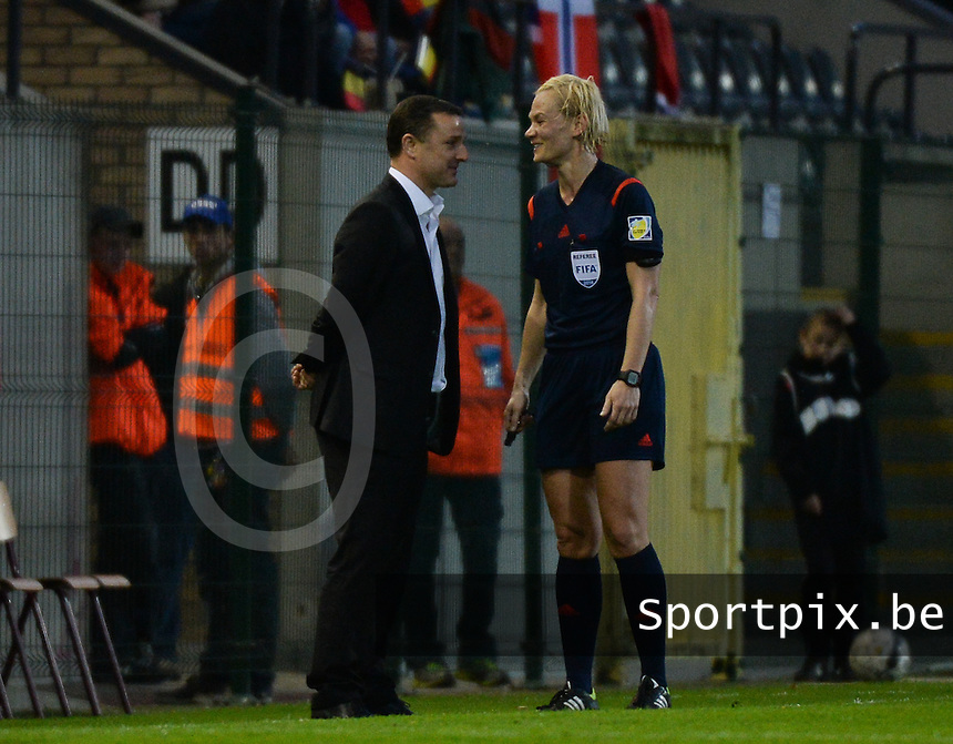 20140410 - LEUVEN , BELGIUM : Belgian coach Ives Serneels (left) pictured with German Referee Bibiana Steinhaus  during the female soccer match between Belgium and Norway, on the seventh matchday in group 5 of the UEFA qualifying round to the FIFA Women World Cup in Canada 2015 at Stadion Den Dreef , Leuven . Thursday 10th April 2014 . PHOTO DAVID CATRY