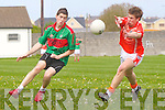 Jamie Culluty gets the ball past Kieran Cahill of Brosna last Sunday in Ballybunnion.