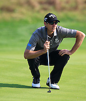 Nicolas Colsaerts (BEL) lines up his putt on the 8th green during Sunday's Final Round of the 2014 BMW Masters held at Lake Malaren, Shanghai, China. 2nd November 2014.<br /> Picture: Eoin Clarke www.golffile.ie
