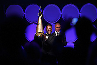 Pele shows off his lifetime achievement award presented by David Beckham during the 2008 Streets to Fields Gala at Gotham Hall in NYC, NY, on March 19, 2008.
