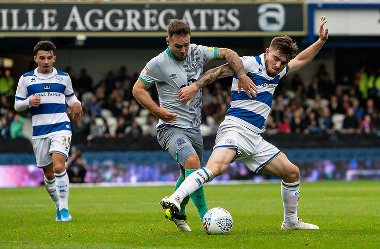 Blackburn Rovers' Adam Armstrong (centre) competing with Queens Park Rangers' Ryan Manning (right) <br /> <br /> Photographer Andrew Kearns/CameraSport<br /> <br /> The EFL Sky Bet Championship - Queens Park Rangers v Blackburn Rovers - Saturday 5th October 2019 - Loftus Road - London<br /> <br /> World Copyright © 2019 CameraSport. All rights reserved. 43 Linden Ave. Countesthorpe. Leicester. England. LE8 5PG - Tel: +44 (0) 116 277 4147 - admin@camerasport.com - www.camerasport.com