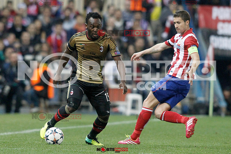 Atletico de Madrid's Gabi Fernandez (r) and AC Milan's Michael Essien during Champions League 2013/2014 match.March 11,2014. (ALTERPHOTOS/Acero)