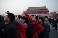 13 March 2012, around 18h25, 8&deg;C.<br /> Dozens of onlookers are gathered at Tiananmen Square to see the national flag ceremony organized everyday at sunrise and sunset.  On the other side of the square, the Two Assemblies are finishing their annual sessions. In the background the balcony where Mao Zedong has declared the foundation of the RPC in 1949.