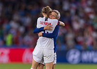 PARIS,  - JUNE 28: Becky Sauerbrunn #4 celebrates with Megan Rapinoe #15 during a game between France and USWNT at Parc des Princes on June 28, 2019 in Paris, France.