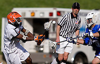 Rhamel Bratton (3) of Virginia takes a shot past Dan Theodoridis (46) of Duke during the ACC men's lacrosse tournament semifinals in College Park, MD.  Virginia defeated Duke, 16-12.