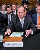 R. Alexander Acosta, Dean of Florida International University College of Law and United States President Donald J. Trump's nominee for US Secretary of Labor, arranges the table prior to his confirmation hearing before the US Senate Committee on Health, Education, Labor & Pensions on Capitol Hill in Washington, DC on Wednesday, March 22, 2017.<br /> Credit: Ron Sachs / CNP