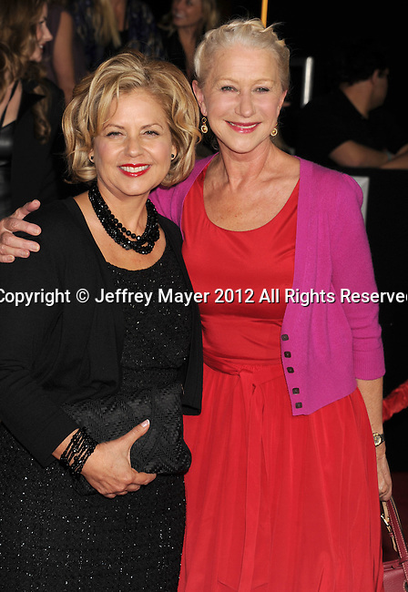 LOS ANGELES, CA - FEBRUARY 22: Mayes Rubeo and Helen Mirren attend the 'John Carter' Los Angeles premiere held at the Regal Cinemas L.A. Live on February 22, 2012 in Los Angeles, California.