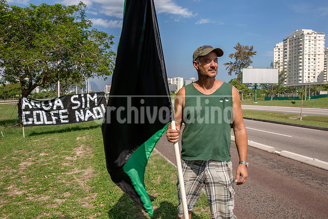 Biologist Marcello Mello, member of the resistance movement known as ìGolfe Para Quem?î (ìGolf for Whom?î) by the green and black flag, representing nature (green) and its death (black).<br /> 5