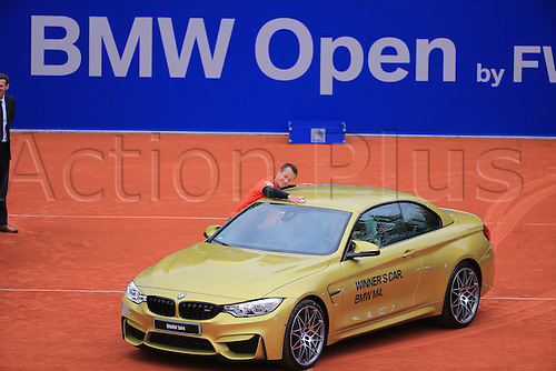 01.05.2016. Munich, Germany. BMW Open 2016 MTTC Iphit Munich singles final.  Winner Philipp Kohlschreiber (GER) with his trophy and prize winners BMW car. Kohlschreiber beat Dominic Thiem (aut) in 3 sets.