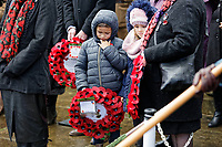 Pictured: Two young children observe a minute's silence. Sunday 11 November 2018<br /> Re: Commemoration for the 100 years since the end of the First World War on Remembrance Day at the Swansea Cenotaph in south Wales, UK.