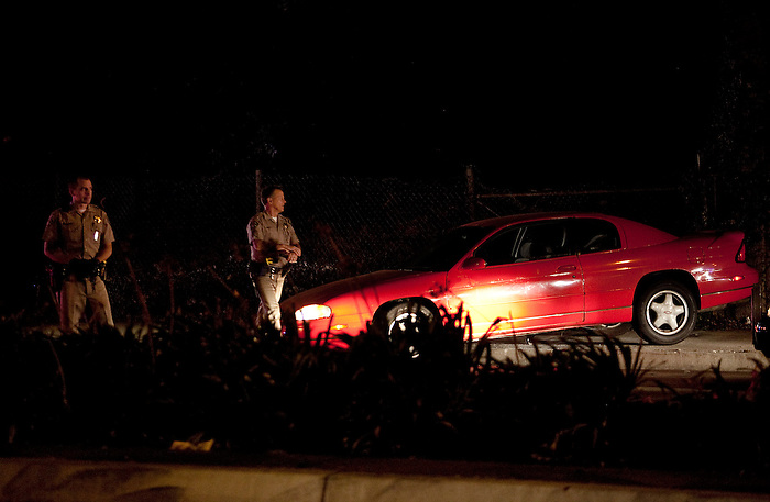 California Highway Patrol officers investigate the car that was involved in a low speed chase on the 110 and 405 freeways in West Los Angeles.  The chase eventually ended in Lawndale on Artesia Boulevard and the 405 freeway where the driver of the vehicle was taken into custody.