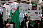 Palestinian women supporters of the Hamas Islamist movement demonstrate in the West Bank city of Hebron on May 04, 2011 as Palestinians in the West Bank and Gaza Strip gather to celebrate and welcome a reconciliation deal signed by rival movements Hamas and Fatah in Cairo. Photo by Najeh Hashlamoun