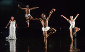 """L-R: Kirsty Hopkins, Eric Brahmenia, Otis-Cameron Carr and Pieter Symonds. Rambert Dance Company perform the new pice """"Labyrinth of Love"""" by choreographer Marguerite Donlon at Sadler's Wells Theatre, London. Music by Michael Daugherty, visual imagery by Mat Collishaw. With the soprano Kirsty Hopkins. Photo credit: Bettina Strenske"""