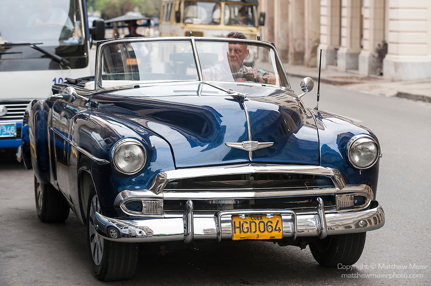 Havana, Cuba; a classic blue 1952 Chevy convertible, parked on the street in Old Havana