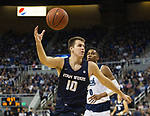 Utah State center Quinn Taylor (10) grabs a rebound against Nevada in the second half of an NCAA college basketball game in Reno, Nev.,  Wednesday, Jan. 2, 2019. (AP Photo/Tom R. Smedes)
