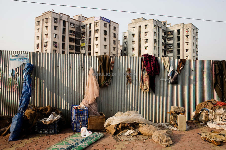 """""""slum rehabilitation"""" project forced people to move to places like the Lallubhai Compound in Mankurd, where buildings cluster ominously, each separated from the other by a small corridor full of garbage. More than 60,000 people live in this new kind of slum after their homes were demolished 19 November 2009."""