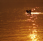 Hoi An Sunrise 03 - Small boat on the Thu Bon river at sunrise, Hoi An, Viet Nam