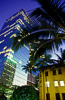 Pacific Guardian Life Building on the left, Dillingham Transportation Building on the right on Bishop St., in downtown Honolulu at dusk