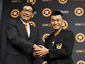 (L-R) Norihiro Komada, Norichika Aoki (Astros),<br /> JUNE 11, 2017 - MLB :<br /> Norichika Aoki of the Houston Astros receives his Golden Players Club jacket from Norihiro Komada, a member of the Meikyukai (Golden Players Club), during a press conference after the Major League Baseball game against the Los Angeles Angels of Anaheim at Minute Maid Park in Houston, Texas, United States. He marked his 2000th career hit in the game to be inducted into the Meikyukai (Golden Players Club). (Photo by AFLO)