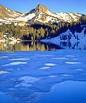 USA; California; Sierra Nevada Mountains,  A partially frozen Skelton Lake