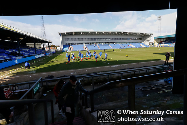 Portsmouth players begin their warm up. Oldham v Portsmouth League 1