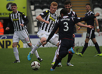 Conor Newton tries to block the clearance of Benjamin Gordon in the St Mirren v Ross County Scottish Professional Football League Premiership match played at St Mirren Park, Paisley on 3.5.14.