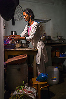 Cheekata  Srujana, 18, cooks a meal for her family in Peddapur, a remote village in Warangal, Telangana, India, on 22nd March 2015. Cheekata only uses safe water for all her cooking and drinking needs of the family. Photo by Suzanne Lee/Panos Pictures for Safe Water Network