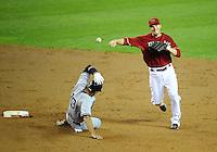 Jun. 22, 2010; Phoenix, AZ, USA; New York Yankees baserunner Alex Rodriguez (13) is forced out at second base by Arizona Diamondbacks shortstop Stephen Drew at Chase Field. Mandatory Credit: Mark J. Rebilas-