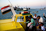 People board a tour boat from the harbor visitors' center in Aden, Yemen, Dec. 2, 2009. Nearly a decade has passed since the USS Cole bombing in Aden's Port. Yemen's weak central government and porous borders make it fertile ground for extremists to operate in. Lawlessness, growing poverty, a water crisis, a raging conflict with Houthi rebels in Yemen's north and clashes with separatists in the South continue to destabilize the Arabian Peninsula's poorest state.