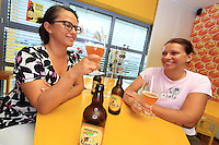 Slovenia -  In the town of Lesce, at the associative centre for apiculture, two young women sample the beer made of honey. ///Slovénie -  Dans la ville de Lesce, au centre d'apiculture associatif, deux jeunes femmes dégustent une bière au miel.