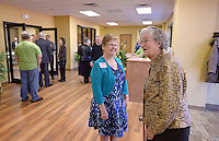 NWA Democrat-Gazette/BEN GOFF @NWABENGOFF<br /> Paula Osterberger (left) of Bella Vista greets Doris Tallaksen of Rogers as she arrives on Sunday Nov. 8, 2015 for the first service in the new building of Village Bible Evangelical Free Church in Bella Vista.